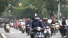 Hanoi traffic during rush hour, motorbike riders wearing face masks, Vietnam Stock Footage