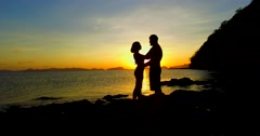 Silhouettes loving couple at sunset on the Philippine Islands - stock footage