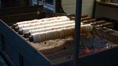 Traditional Czech Trdelnik or Trdlo Baked at a Market Stock Footage