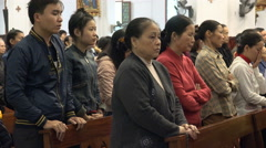 People attend a Catholic church mass in Hanoi, Vietnam, Asia Stock Footage