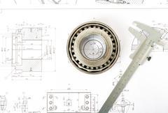 Roller bearing on blueprints Stock Photos