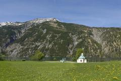 Stock Photo of Lighthouse and Seehof chapel at Achensee Seekarspitze behind Achenkirch Tyrol