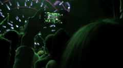 Girl taking photo with smartphone in the club at the concert, 4k - stock footage