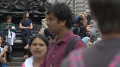 People standing near Shaftesbury Memorial Fountain in London Stock Footage