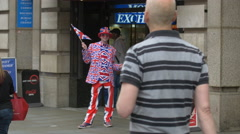 Man with an English flag costume in London Stock Footage