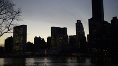 Time lapse of lower Manhattan sunset from Roosevelt Island. Stock Footage