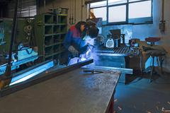 Stock Photo of Welder at work agricultural machinery Middle Franconia Bavaria Germany Europe