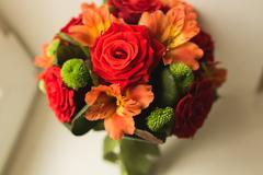 Beautiful luxury wedding bouquet of red flowers - stock photo