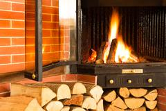 Hot wood fire burning in a chimney insert Stock Photos
