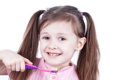 Child decayed teeth with toothbrush on white background Stock Photos
