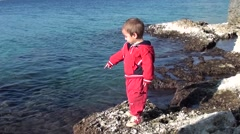 Toddle near the sea watches and learns Stock Footage