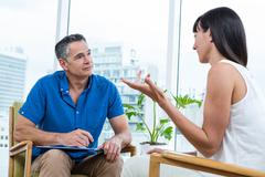 Woman consulting a therapist Stock Photos