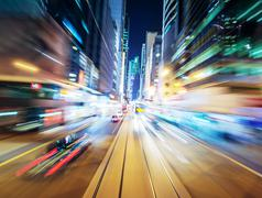 Abstract urban background of night city blurred by motion - stock photo