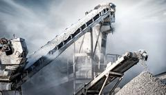 Cement production factory on mining quarry. Conveyor belt of heavy machinery  Stock Photos