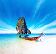 Scenic getaway background of thai boat on exotic beach of tropical island  Stock Photos