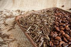 Dried tea leaves and roasted coffee beans: theine vs caffeine Stock Photos