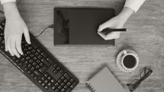 Professional creative graphic designer desk in black and white Stock Footage