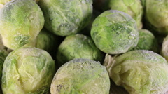 Frozen green brussels sprouts. Stock Footage
