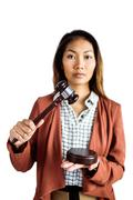 Businesswoman banging a law hammer on the gavel - stock photo
