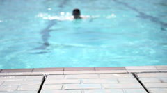 Young man swimming in swimming pool Stock Footage