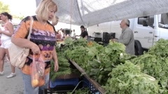 Woman seeking herbs that wants to buy them in vegetable market 8 Stock Footage