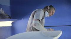Man making new surfboard - stock footage