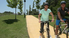 Mature couple on bicycles Stock Footage