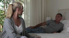 Mature couple in bedroom Stock Footage