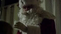 Santa Claus drinking milk Stock Footage