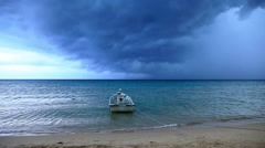 Boat moored at shore in thunder storm, Petani Beach, Perhentian Kecil,  - stock footage
