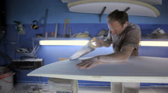 Man sawing new surfboard Stock Footage