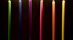 Lit candles with blue candle melting, time lapse - stock footage