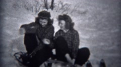 1944: Women putting on winter snow ski boots and socks on metal sled.  TROY, NEW Stock Footage