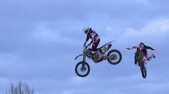 Freestyle Motocross riders doing crazy tricks. Slow motion. Stock Footage