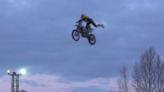 Freestyle Motocross riders doing crazy tricks. Slow motion. - stock footage