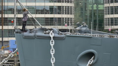 Woman taking pictures at HMS Belfast museum in London Stock Footage