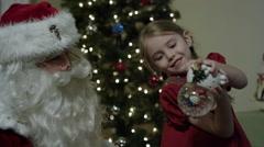 Santa Claus' visit on Christmas Eve - snow globe - stock footage