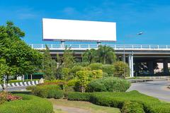 Blank billboard ready for new advertisement with garden - stock photo
