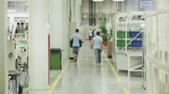 Time lapse of people who moved in the factory, production. 4K video Arkistovideo