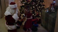 Santa Claus tells girl to go back to sleep Stock Footage