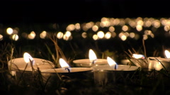Candles on Grass at Night Stock Footage