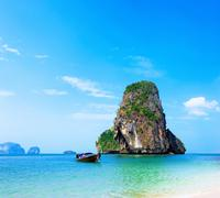 Thailand ocean beach. Thai journey scenery landscape  with wooden boat - stock photo