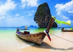 Traditional boat on beach in Thailand near Phuket island Stock Photos