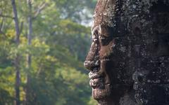 Profile view of ancient sculpture in Angkor Wat historical site in Cambodia Stock Photos