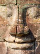 Angkor Wat Cambodia close up view of face carved on stones Stock Photos