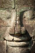 Bayon temple in Angkor Thom site in Cambodia. Smiling face murals Stock Photos