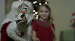 Santa Claus' visit on Christmas Eve - Snow Globe and girl Stock Footage