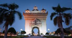 Laos Vientiane night view of famous landmark and destination Patuxai Arch Stock Photos
