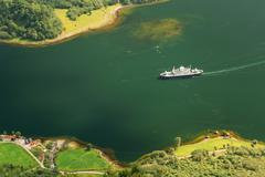 Pleasure boat ship are sailing between fjords. Amazing nature of - stock photo