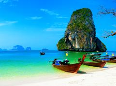 Thailand ocean beach. Thai journey scenery landscape  with wooden boats - stock photo